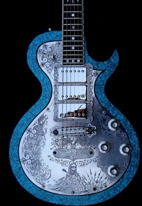 Blue and silver guitar with skeleton, swirls and flowers Artist Guitars Australia - http://www.kangabulletin.com/online-shopping-in-australia/artist-guitars-australia-the-home-of-guitar-enthusiasts/ #artist #guitars