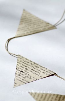 make bunting from kitchen twine & vintage book page to adorn wrapping