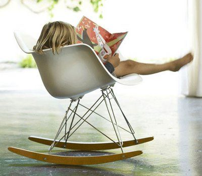 Reading in a Eames Plastic RAR  (Rocking Armchair Rod base)