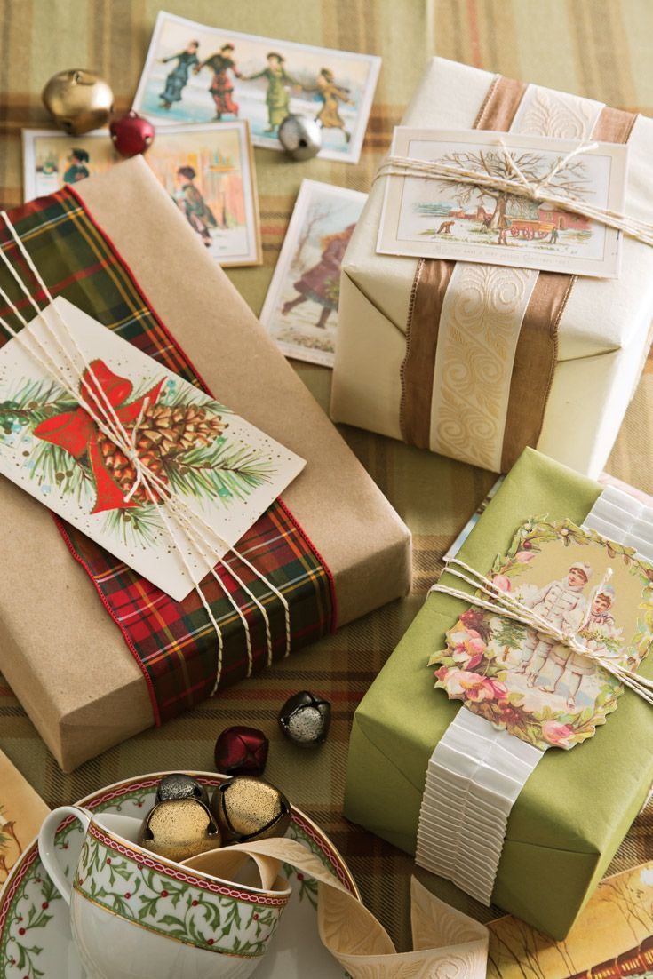 Slipped beneath twine, vintage postcards add nostalgic charm to these Christmas packages.