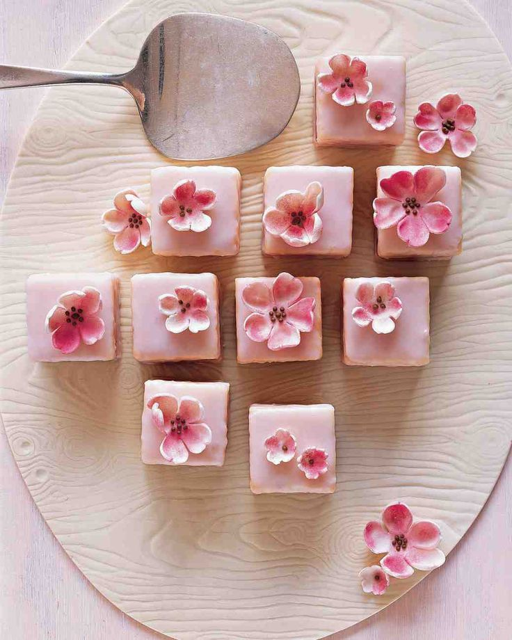 Spring Shower Almond Petits Fours | Martha Stewart Living - Top pink almond petits fours with gum-paste cherry blossoms for a dessert that will brighten any table.