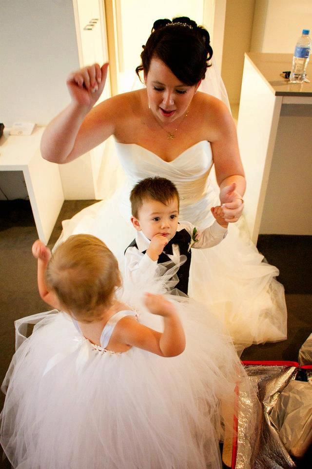 My gorgeous daughter on her wedding day with my grand daughter and grand son