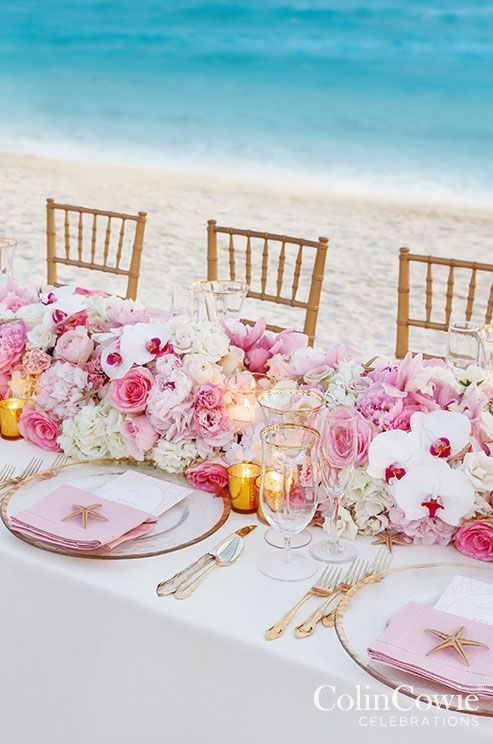 Romantic intimate pink beach wedding reception; Featured Photographer: Colin Miller, Via Colin Cowie Weddings
