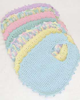 Easy-to-crochet baby bibs and booties are practical and make an excellent gift. To fit newborn to 6 mos. Made in Bernat Handicrafter Cotton on size 5 mm (U.S. H or 8) crochet hook.