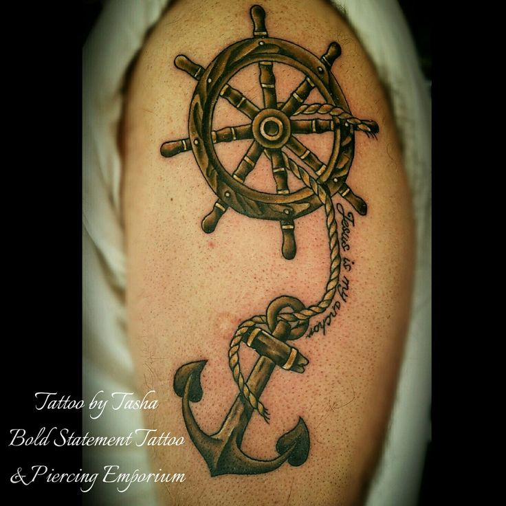 Wooden anchor and ship's wheel tattoo