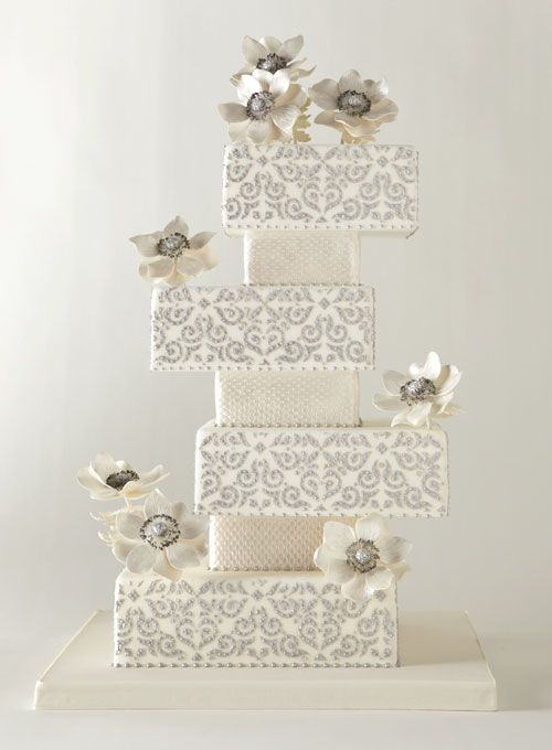 Geometric stackied tier inspired by the game Jenga #weddings #weddingcake