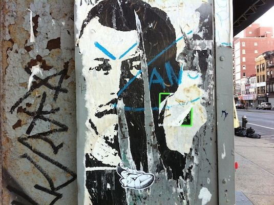Wheatpaste street art poster image of Czar Alexander at the entrance to the New Museum on the Bowery in New York City.