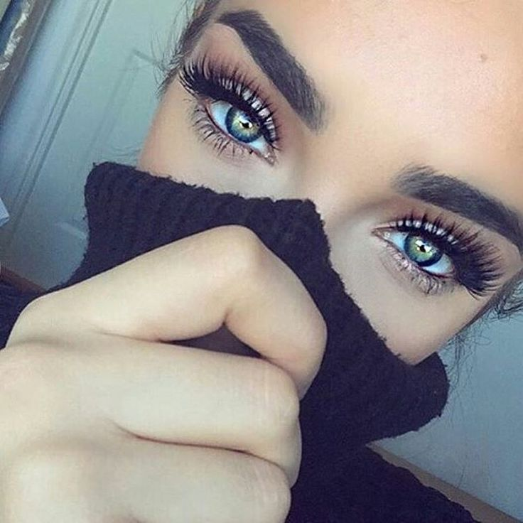 Long eyelashes, thick eyebrows, green eyes, eye makeup