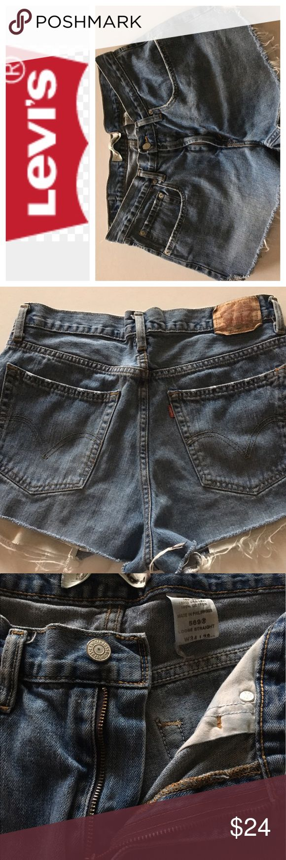 """💸Levi's 569 denim cutoffs in size 36 💸Levi's 569 denim cutoffs in size 36 inseam 3"""" and leg opening 13"""" across. I cut these myself because original inseam was 28 and hems were worn out. Hope you like them! Levi's Shorts Jean Shorts"""