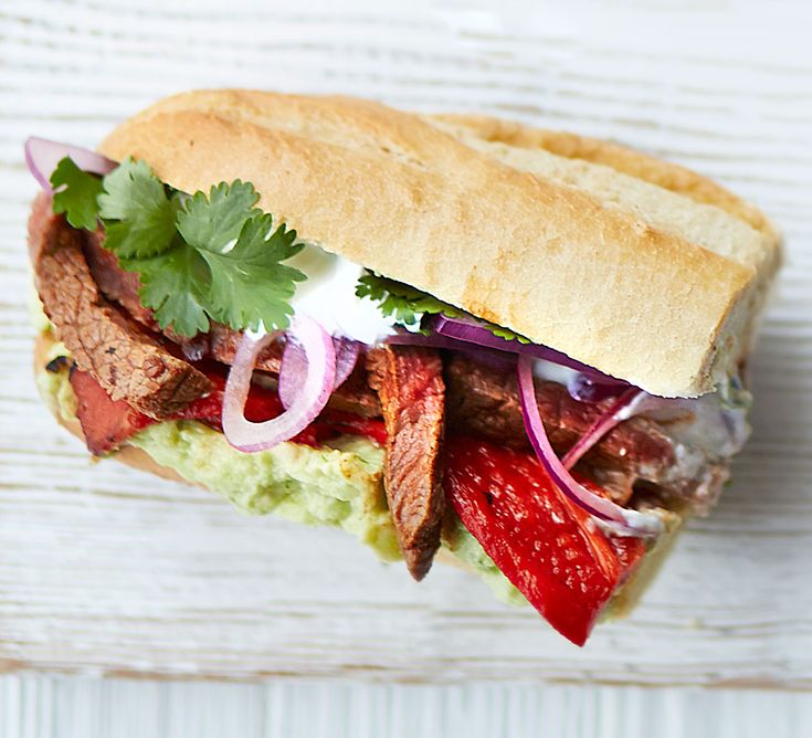 Sizzled chipotle steak sarnies. Give your sandwich a gourmet Mexican makeover - fill a crusty baguette with seared sliced steak, mashed avocado and roasted peppers