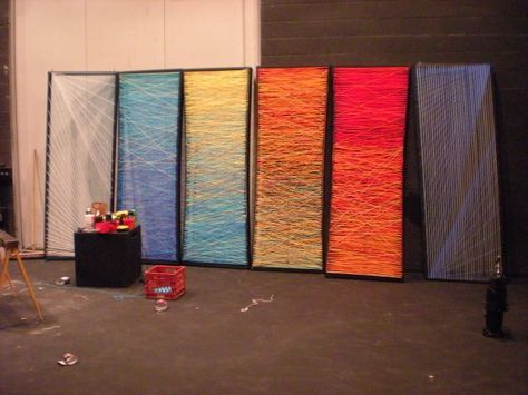 Yarn strung across wood frames.  Light colored with uplights might be cool.  Cheap and covered a lot of space.