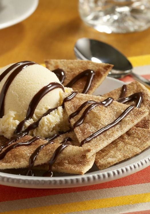 These Cinnamon Dessert Nachos are irresistible! This recipe combines ice cream, baked cinnamon sugar coated tortilla chips, and chocolate syrup!