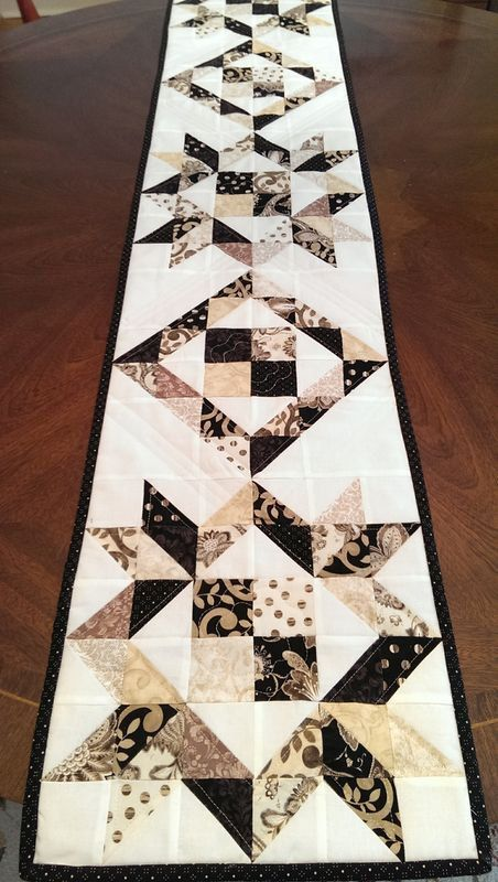 This gorgeous table runner in blacks, beiges, and white is my take on modern…