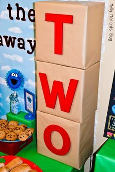 3D birthday boxes displayed at a Sesame Street / Elmo Themed Birthday Party for kids! DIY decorations, free printables to download, and many festive party flare items at Melly Moments Blog! Save time, energy, and money with these party planning ideas!