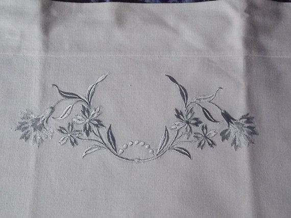 White vintage cotton pillowcase with blue embroidery by Deccorista