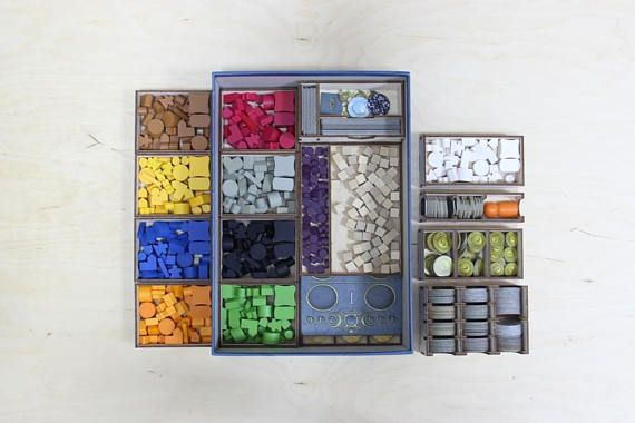A plywood insert   organizer for Terra Mystica.  - 100% organic plywood; - Works with fire and Ice expansion; - Separate removable trays for game components; - Almost all trays have engravings; - No need to play Tetris when trying to fit in all the wooden pieces! - Pre-game stage takes about 2-3 minutes.  Please note that this item is an insert   organizer - no game components included. Item requires no glue/hammer for building but it is ok to use some glue if you want your insert   orga...