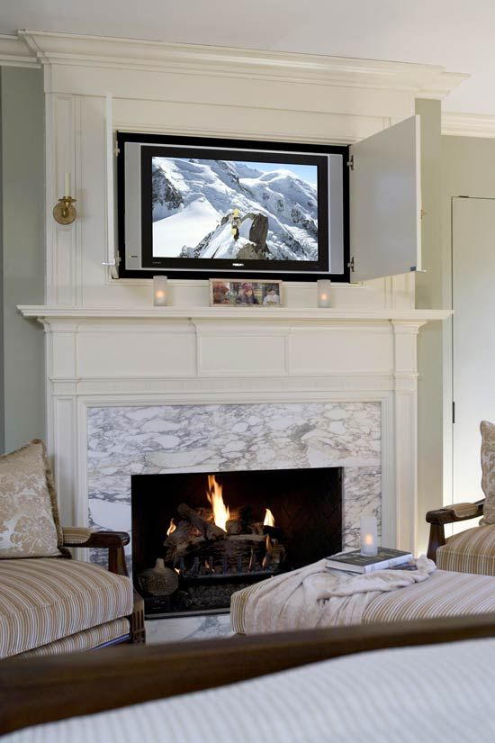 Flat Panel TV Tucked Behind Mantel Cabinet Doors: Meredith Vieira's Home; Traditional Home