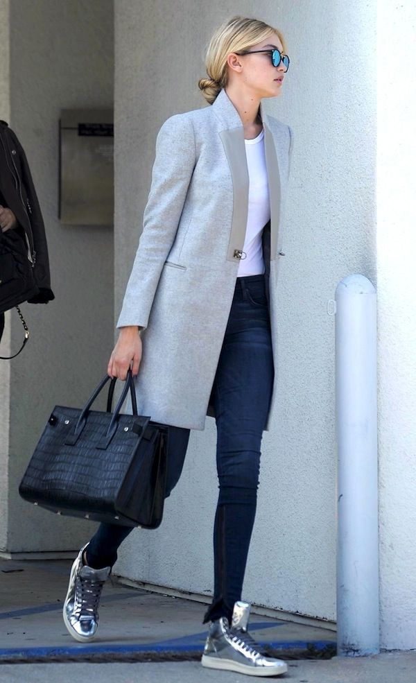Le Fashion Blog Gigi Hadid Fall Style Low Bun Mirrored Sunglasses Grey Coat White Tee Skinny Jeans Saint Laurent Croc Bag Silver Sneakers #NaaiAntwerp