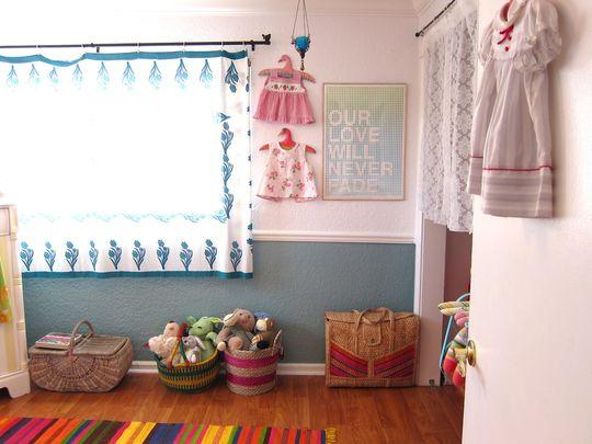 colorful baskets as floor storage- Marlowe's Bright Bohemian Room
