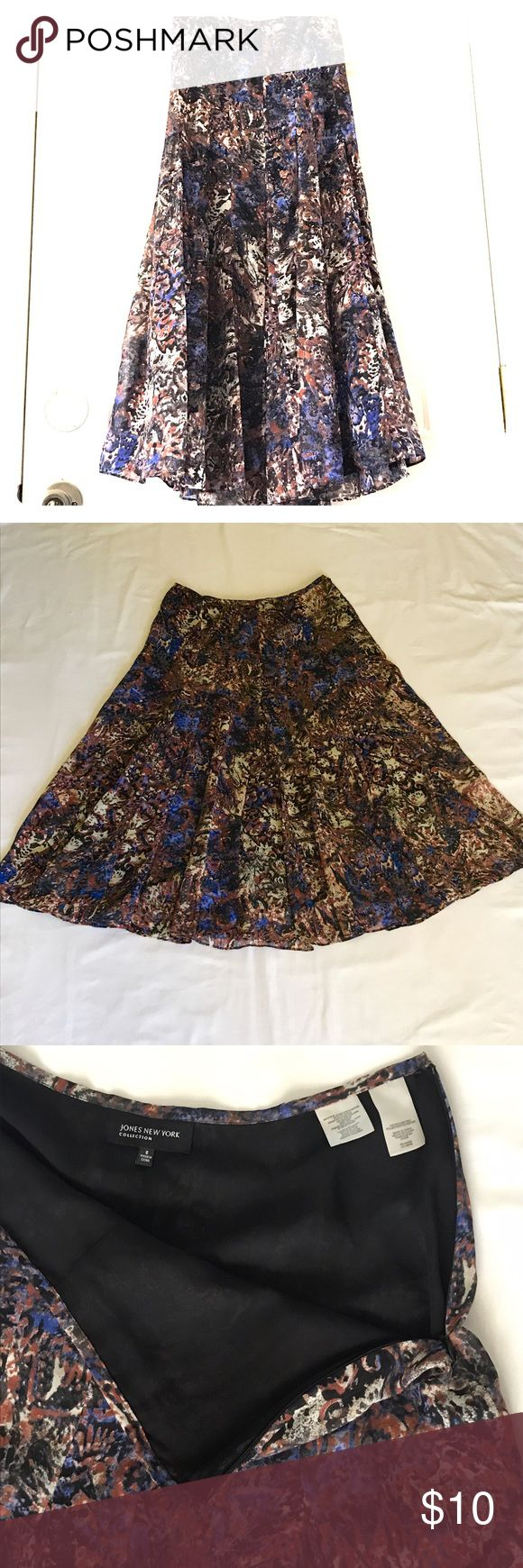 """Jones New York long circle skirt Long circle skirt with blue, cream, red, and black design.  100% polyester.   Great condition.  Side zipper closure.  Waist 15"""", length 31"""" flat.  Made by Jones New York.  Size 6. Jones New York Skirts Circle & Skater"""
