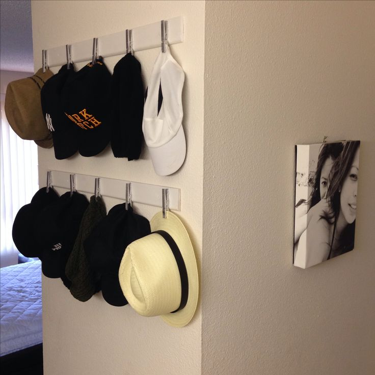 DIY clothespin hat rack. crown moulding + clothespin (spray painted) = clothespin hat rack!