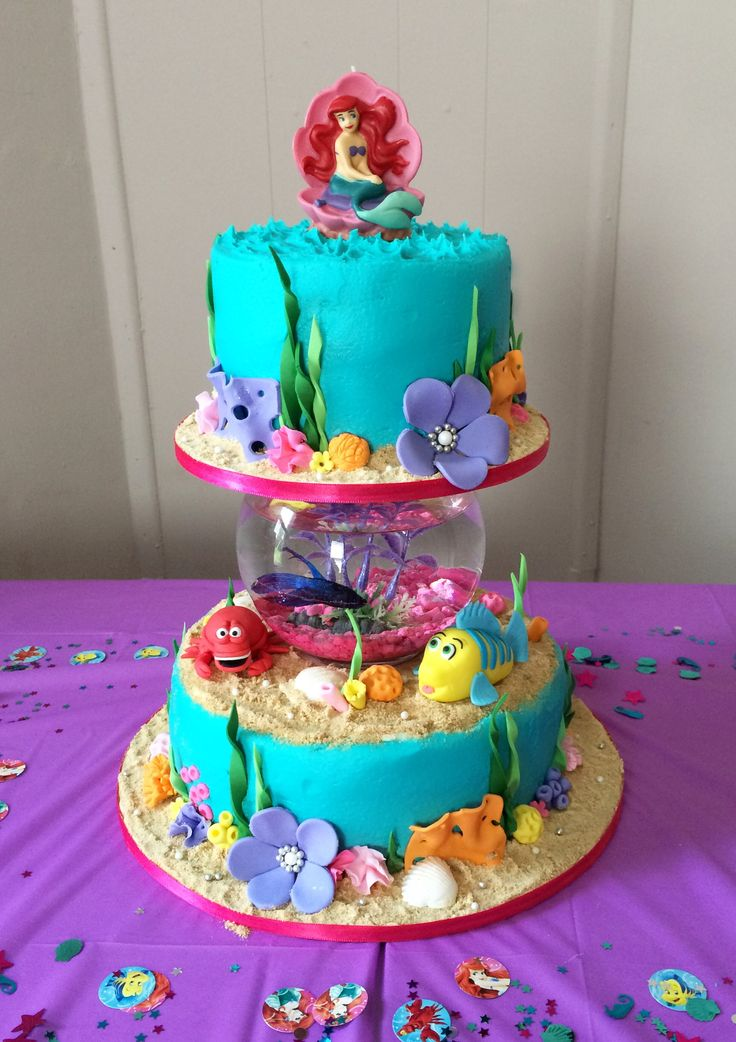 Little mermaid cake with a real fish in the bowl
