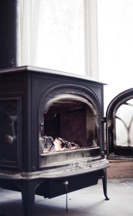 Pot belly stove black white pinterest stove pots and living rooms for Living room with wood burning stove