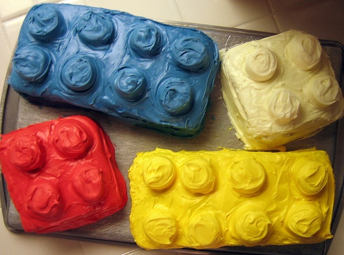 Lego Cakes by breeleed, via Flickr -- Happy Birthday. This would be easy to do with a normal cake pan and cupcakes on the top. Then just frost the entire cake.