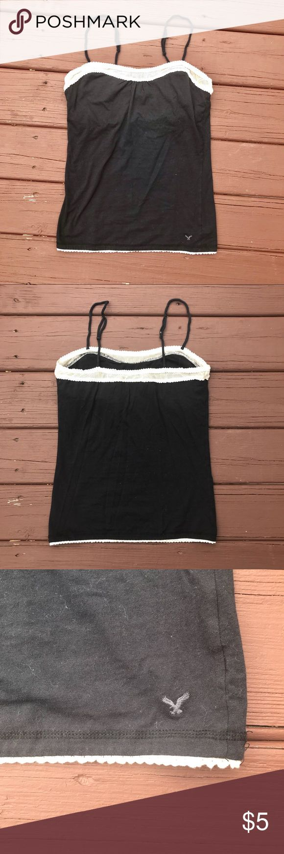American Eagle Black Cami With White Trim Black cami from American Eagle with pretty white lace trim. It's comfy and 95% cotton, 5% spandex. The measurements are: Underarm to underarm: 16in Underarm to bottom: 18in American Eagle Outfitters Tops Camisoles