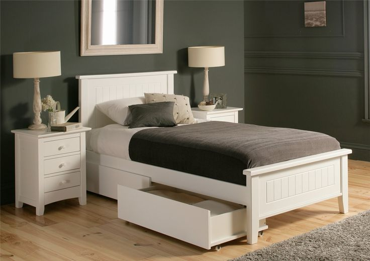 The New England bed merges country styling with a clean painted finish. By contrasting the delicate white painted frame with a bold proven design, New England achieves elegance and practicality and feels at home from master to childrens room. Made in solid wood sourced from sustainable plantations and finished in a white painted finish. Its understated style will fit easily into any home and with a fully sprung slatted base, comfort is guaranteed.Underbed clearance is 23cm.  NB Drawers are…