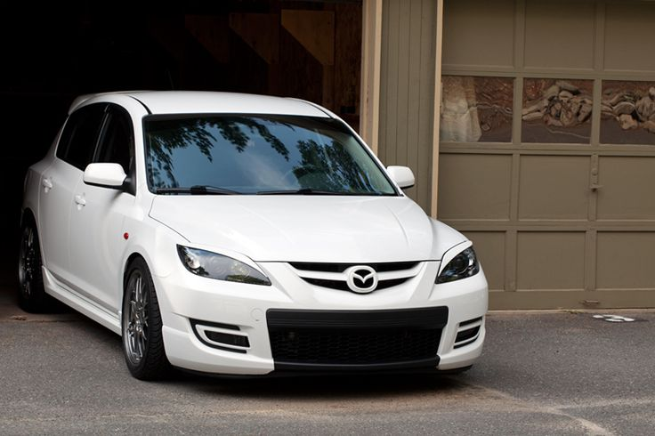 Mazdaspeed painted front bumper extending lower grill & white painted emblem to match car