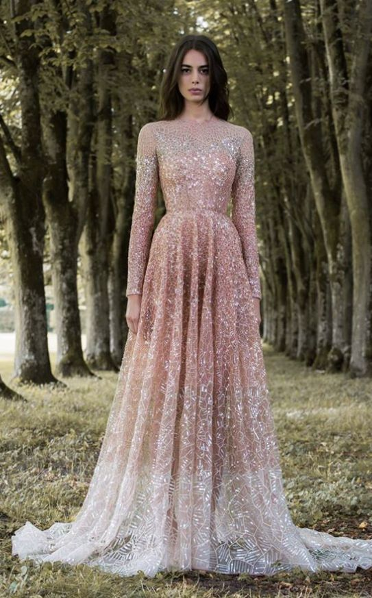 Glamorous long-sleeve metallic beaded blush pink wedding dress; Featured Dress: Paolo Sebastian