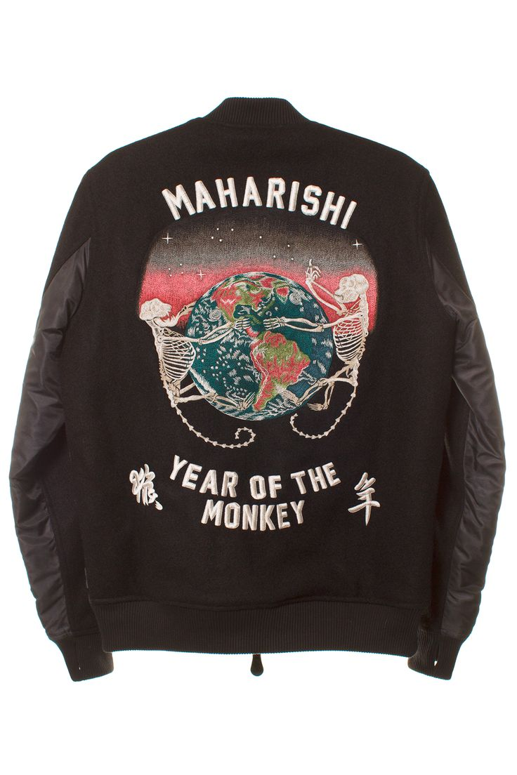 MAHARISHI BLACK YEAR OF THE MONKEY JACKET Black nylon and wool bomber jacket featuring Maharishi Year of the Monkey embroidery on back, NASA-style patch on front, and quilted lining. Panels: 100% nylon. 100% shelton wool. SIZE & FIT Fits true to size. MAHARISHI Maharishi is the environmentally sound, fair-trade conscious, oxymoronic Japanese label known for mixing a military aesthetic with graphics associated with peace in long-lasting, quality pieces. Founded in 1994 by Hardy Blechman.
