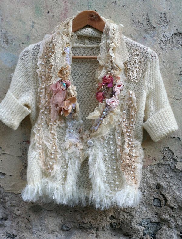 Feminine romantic reworked mohair jacket in shades cream, ivory, white, blush... The delicate frothy collar is made of layered antique cotton lace flounces, hems are trimmed with silky fiber all around. The other details include crystals, vintage white glassbeads which look like small snowballs, organza blooms in pink ans salmon, cream chiffon silk strips at front. Fastens with bold pearly button. The size is small-medium, plese see the measurements for reference. Measurements: bust 84-86…