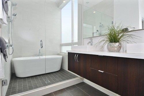 Grey floor tile ... + dark vanity & white counter.  Looks crisp.   Elemental Design, LLC modern bathroom