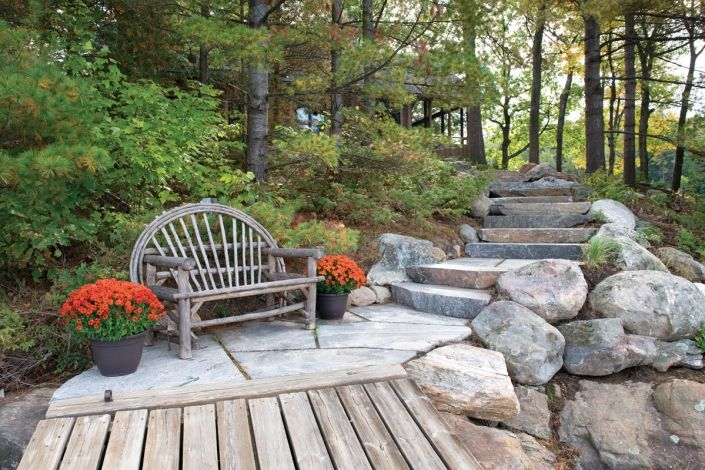 A flagstone landing seamlessly segues the dock to the stone steps at this Georgian Bay South Channel retreat. Combining Muskoka Rock Company landscape products in this way allows property owners to achieve their landscape vision. Pocket gardens accent the featured natural Muskoka granite treads and a relief landing provides a level step or two on your decent to the dock.