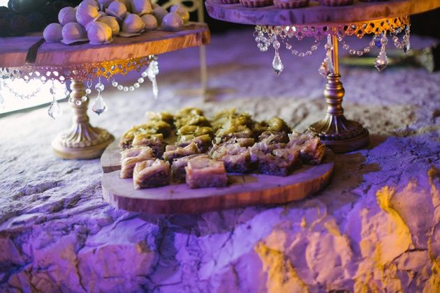Desert buffet with traditional Greek delights and cake pops on romantic cake stands and wooden platter. Photo by Adrian Wood