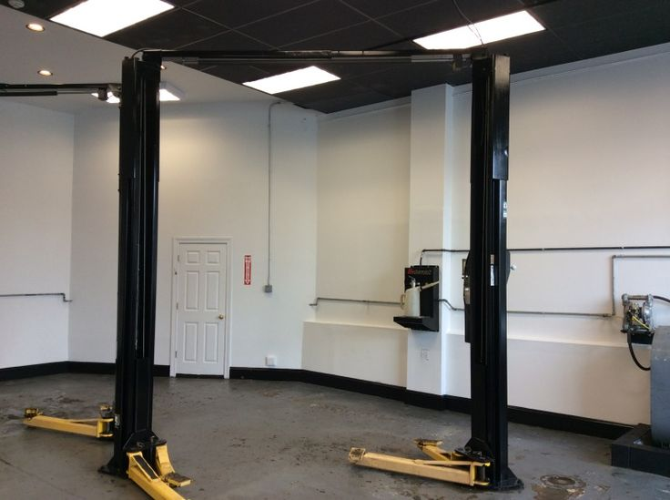 Volvo Dealership Interior Painting Summit- Our team performed a full interior paint job, including the walls, and car lifts of this Summit Volvo dealership.