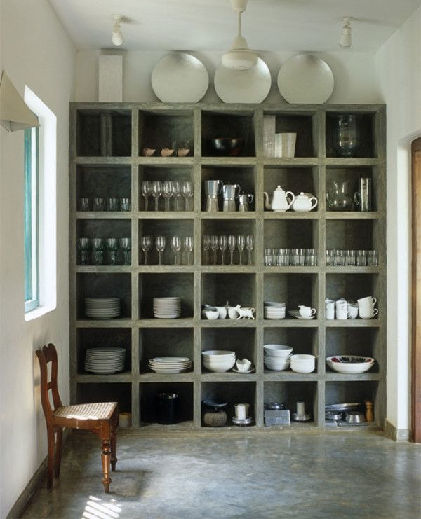 12 Concrete Interiors: Concrete cubbies might not be your first choice for storing porcelain, but the chunky concrete shelving unit is gorgeous. The floor in the kitchen of this house in Sri Lanka, by architect Geoffrey Bawa, is polished concrete too.