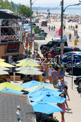large group of people at beach. - Overhead view of people walking on the boardwalk along Wasaga Beach, Canada