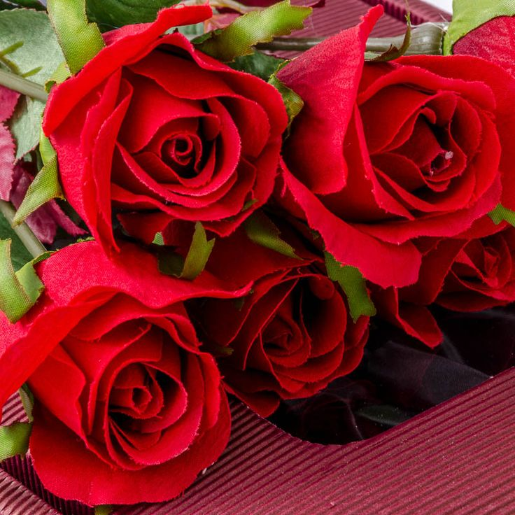 Silk red roses. A romantic expression of love.