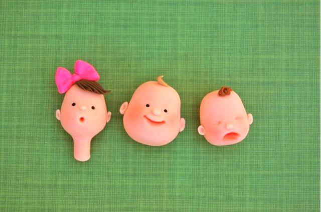 Three Finished Fondant Baby Faces - cake decorating tutorial