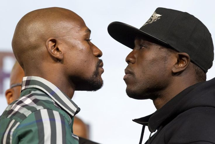 Undefeated WBC/WBA welterweight champion Floyd Mayweather Jr. (L) faces off with challenger Andre Berto during a news conference at MGM Grand Hotel & Casino in Las Vegas September 9, 2015. Mayweather will defend his titles against Berto at the MGM Grand Garden Arena on Sept. 12 in what he says will be his final fight. REUTERS/Las VegasSun/Steve Marcus