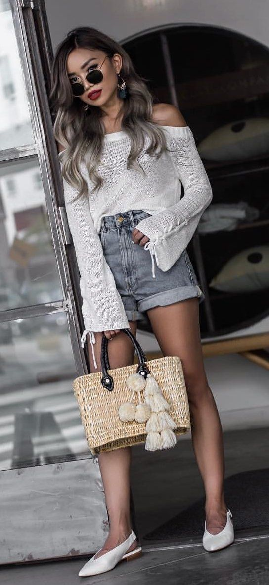 6d277ee960  winter  outfits black framed aviator style sunglasses  white off-shoulder  long-sleeved shirt  blue denim cuff short shorts outfit