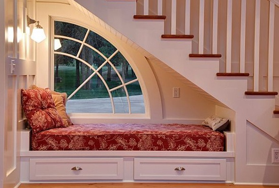 Under Staircase Reading Nook:  looks a little like heaven to me