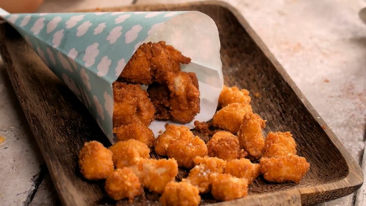 Recipe with video instructions: Because everything tastes better bite-sized and rolled in cornflakes. Ingredients: 1 chicken breast, A handful of corn flakes Nature, 2 eggs, Flour, Paprika, Salt, Frying oil