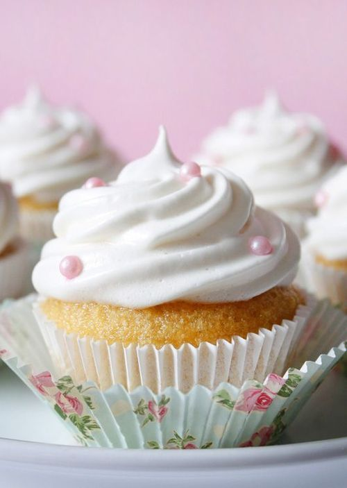 cute cupcake with delicious white frosting and pink pearls