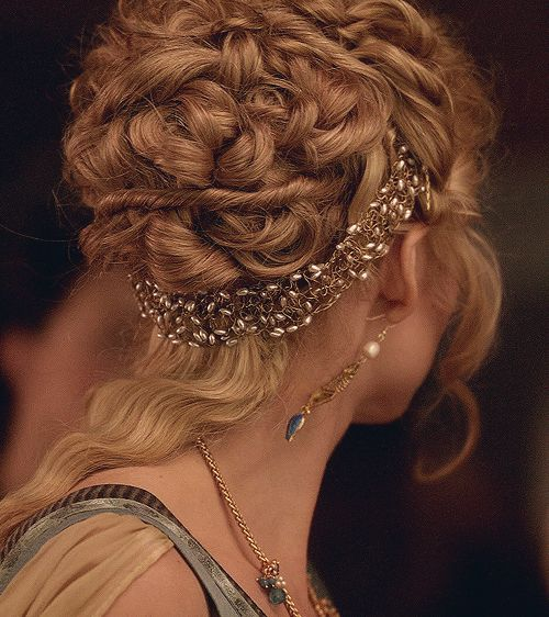I don't like that strip running between those luscious curls but what a beautiful updo otherwise