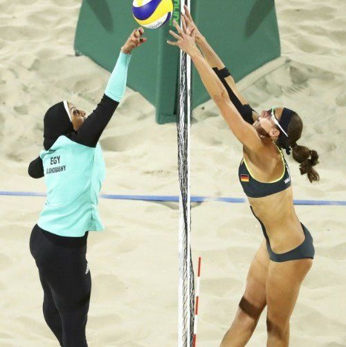 Quite accidentally i' ve found this pic and the nearly endless konv at twitter about the clothing of this two admirable ladies, who both worked as hard as they  could for being part of this championship. Freedom & peace for everyone.. Regardless of what she/he is wearing.