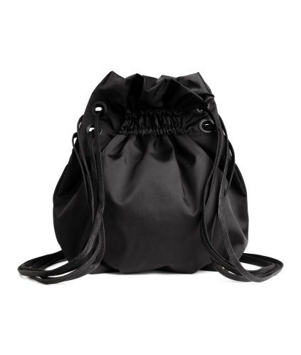 STUDIO COLLECTION. Backpack in twill with a sheen. Double drawstrings at the top that can be used as shoulder straps and three inner compartments, one with